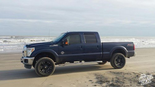 20x9 XD Series Monster Black +18mm wheels with LT295/60/20 Nitto Terra Grappler tires on a 2012 Ford F-250