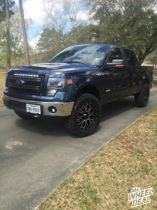 20x9 Helo 879 Gloss Black Machined wheels with 35x12.50x20 Atturo Trail Blade MT tires on a 2013 Ford F-150