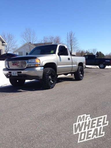 """20x10"""" XD Monster Black Wheels with 33x12.50x20 Nitto Grappler Mud Tires on a 2001 GMC Sierra 1500"""