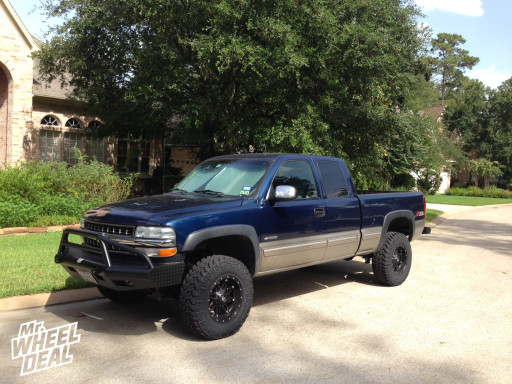 """17x9"""" Fuel Offroad Hostage wheels with LT285/70/17 Nitto Trail Grappler tires on a 2001 Chevy Silverado 1500"""