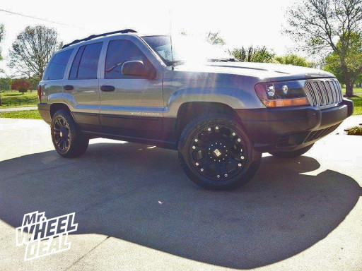 18x9 Black XD Monster Wheels with 255/55/18 Toyo Open Country AT II Tires on a 2000 Jeep Grand Cherokee
