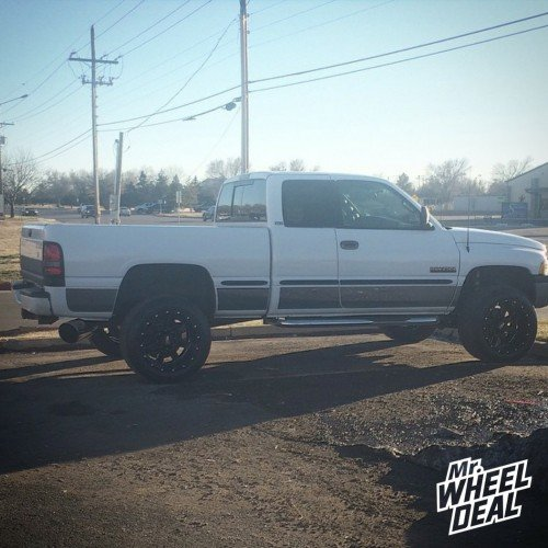 20x12 Moto Metal 962 Black wheels with 305/50/20 Nitto NT420S tires on a 1999 Ram 2500