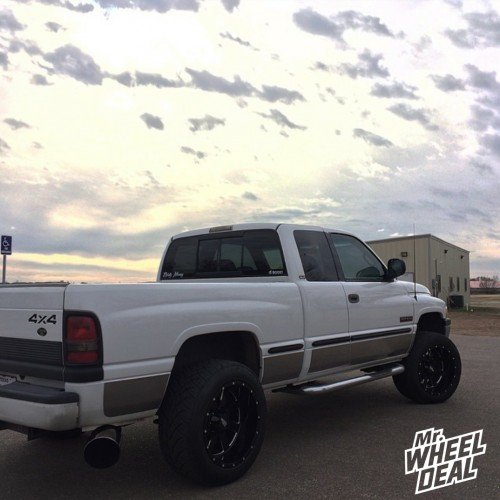 """1999 Ram 2500 with 20x12"""" Moto Metal 962 Black wheels and 305/50/20 Nitto NT420S tires"""