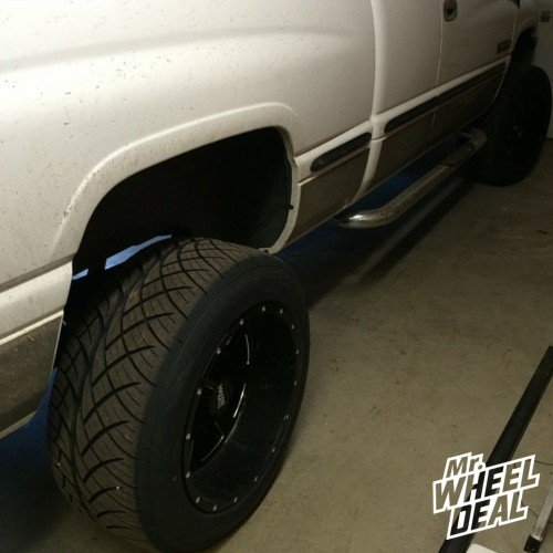 """20x12"""" Moto Metal 962 Black wheels with 305/50/20 Nitto NT420S tires on a 1999 Ram 2500"""