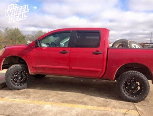 18x9 Black XD Hoss +18 wheels with LT285/65/18 Toyo Open Country AT II tires on a 2011 Nissan Titan
