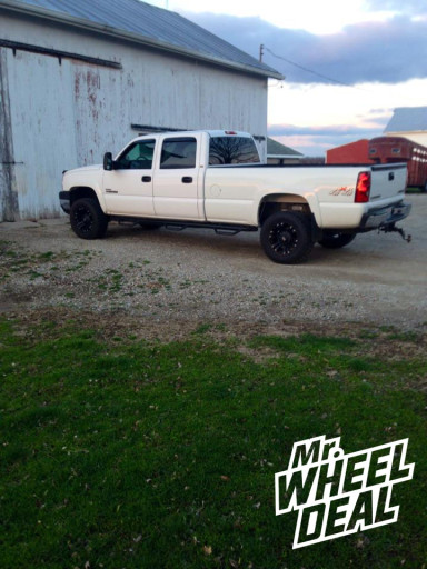 """18x9"""" XD Monster Black Wheels with LT285/60/18 Nitto Terra Grappler Tires on a 2007 Chevy Silverado 2500"""