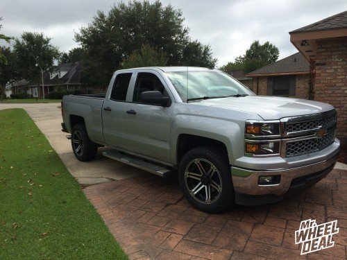 """20x9"""" Tuff T01 Red Black wheels with  275/55/20 Nitto Terra Grappler tires on a 2014 Chevy Silverado 1500"""