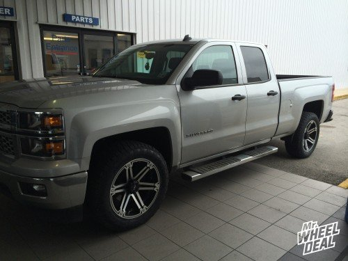 """20"""" Tuff T01 Red Black wheels with  Nitto Terra Grappler tires on a 2014 Chevy Silverado 1500"""