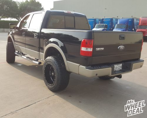 """20x12"""" Moto Metal 962 Gloss Black Milled wheels with 35x12.50R20 Toyo Open Country RT tires on a 2008 Ford F-150"""