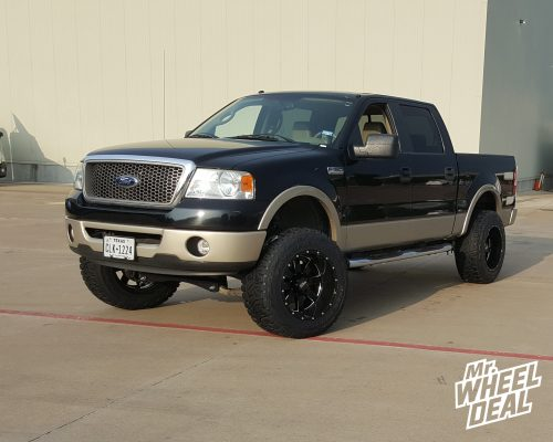 20x12 Moto Metal 962 Gloss Black Milled wheels with 35x12.50R20 Toyo Open Country RT tires on a 2008 Ford F150