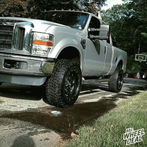 20x10 Fuel Offroad Hostage Black wheels with LT295/60R20 Nitto Terra Grappler G2 tires on a 2010 Ford F350