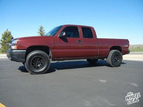 "17x9"" ProComp Series 36 Matte Black -6mm wheels with LT285/75/17 Nitto Terra Grappler G2 tires on a 2003 Chevy Silverado 1500"