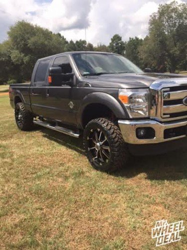 22x9.5 Black Machined XD Badland wheels with 35x12.50x22 Toyo Open Country MT tires on a 2015 Ford F-250