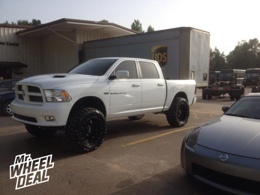"""22x11"""" Fuel Off-Rroad Hostage Wheels with 37X13.50R22 Nitto Mud Grappler Tires on a 2012 Ram 1500"""