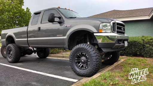 """18x9"""" KMC XD Series Monster Matte Black Wheels with 37x13.50x18 Toyo Open Country MT Tires on a 2004 Ford F-250"""