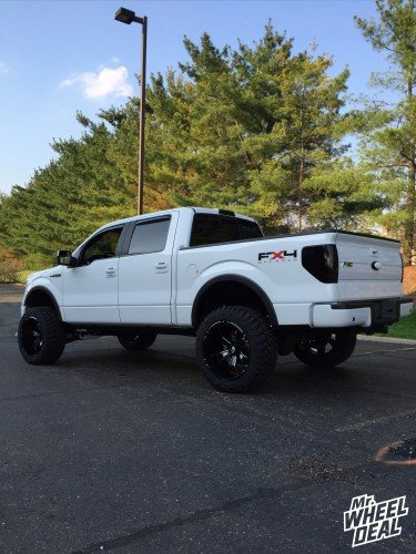"Black Milled 22x12"" Hostile Hammered wheels with 35x12.50x22 Atturo Trail Blade MT tires on a 2009 Ford F-150"