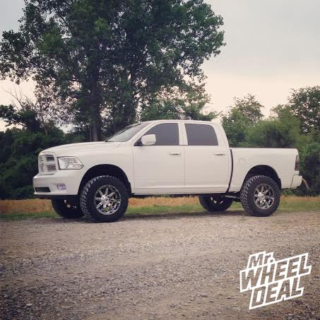 2012 Ram 1500 with 20x10 Fuel Off-Road Nutz Wheels with 35x12.50x20 Nitto Trail Grappler MT Tires