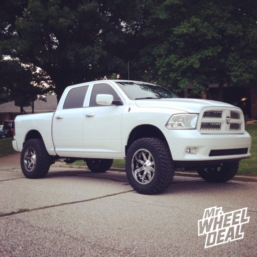 20x10 Fuel Offroad Nutz Wheels with 35x12.50x20 Nitto Trail Grappler MT Tires on a 2012 Ram 1500