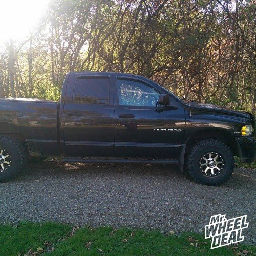 17x9 KMC XD Addict Matte Black Machined wheels with LT265/70/17 Nitto Trail Grappler M/T tires on a 2004 Ram 1500
