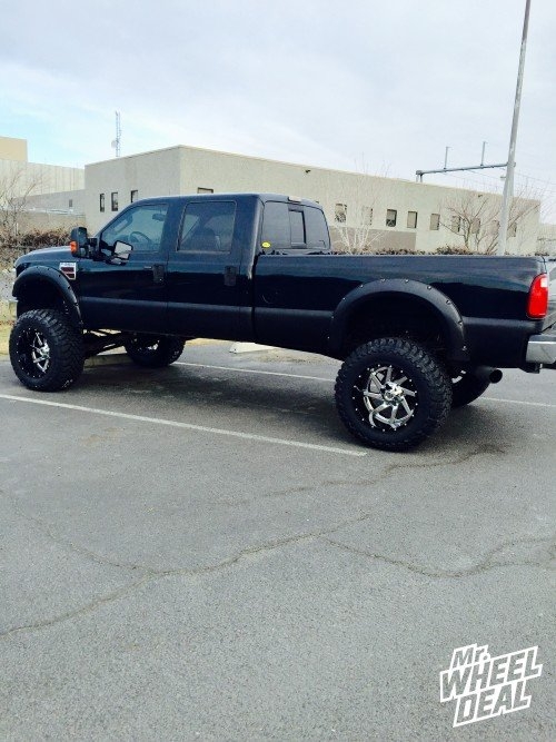 """22x14"""" Black and Chrome Fuel Renegade wheels with 40x15.50r22 Toyo Open Country MT tires on a 2008 Ford F-350"""