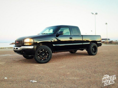 2006 GMC Sierra 2500 with 20x10 Fuel Off-Road Hostage -12mm wheels with 33x12.50x20 Atturo Trail Blade MT tires