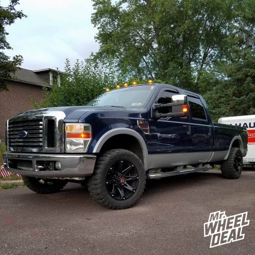 20x9 Ballistic Jester -12mm Full Black wheels with 33x12.50R20 Federal Couragia MT tires on a 2008 Ford F-250