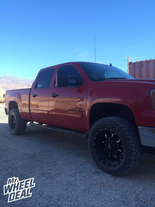 20x10 Fuel Off-Road Krank Black Milled wheels with LT305/55/20 Toyo Open Country A/T II tires on a 2008 GMC Sierra 2500