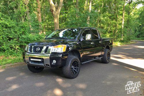 """20x10"""" All Black XD Heist -24mm wheels with 33x12.50r20 Atturo Trail Blade XT tires on a 2008 Nissan Titan"""