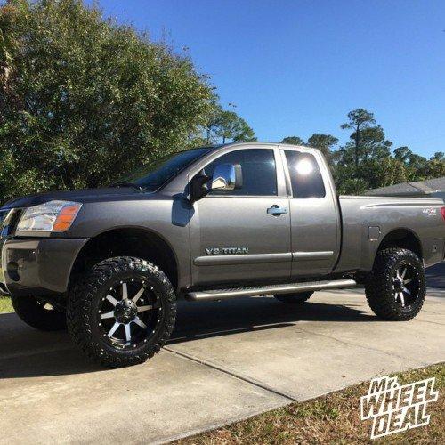 2005 Nissan Titan with 20x10 Fuel Maverick Black wheels and 35x12.50x20 Atturo Trail Blade MT tires