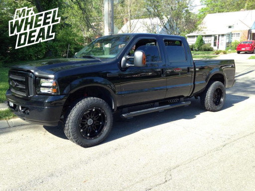 20x10 Fuel Offroad Hostage Wheels with LT305/55/20 Toyo Open Country AT II Tires on a 2005 Ford F250