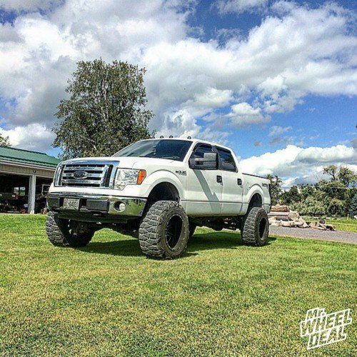 """20x14"""" Fuel Maverick Black Milled wheels with 37x13.50x20 Nitto Mud Grappler tires on a 2009 Ford F-150"""