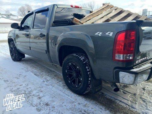"18x9"" Tuff T01 Black wheels with 25mm offset and 285/60/18 Bridgestone DM-V1 Blizzak tires on a 2011 Sierra 1500"