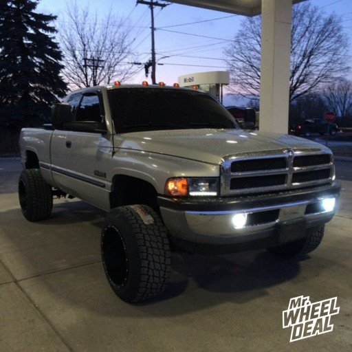 "20x14"" XD Riot Black wheels with LT305/55/20 Nitto Terra G2 tires on a 1998 RAM 2500"