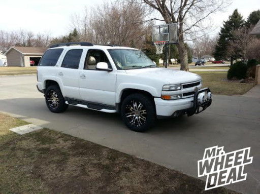 """20x9"""" Helo HE 835 Black Machined Wheels with LT285/55R20 Nitto Terra Grappler Tires on a 2004 Chevy Tahoe"""