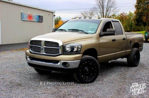 20x10 Fuel Offroad Hostage -12mm wheels with 305/50/20 Nitto NT 420s tires on a 2006 Ram 2500