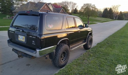 16x9 American Racing AX195 Cornice Black -12mm wheels with 285/75R16 Mastercraft Courser MXT tires on a 1999 Toyota 4-Runner