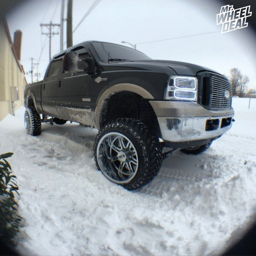 22x14 Ion style 183 Chrome wheels with 35x12.50x22 Atturo Trail Blade MT tires on a 2005 Ford F-250