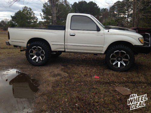 20x9 Tuff T05 Machined wheels -13mm with 33X12.50R20 Federal Couragia MT tires on a 1999 Toyota Tacoma