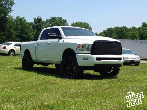 "20x10"" Fuel Offroad Krank Black Milled wheels with LT305/55/20 Mickey Thompson Baja ATZP3 tires on a 2007 RAM 2500"