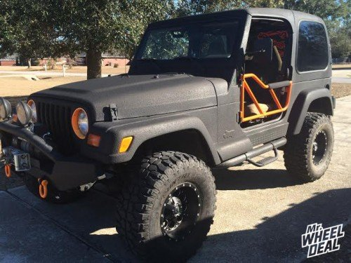 """15x8"""" Fuel Offroad Revolver wheels on a 1998 Jeep Wrangler"""