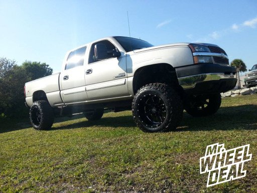 """20x12"""" Moto Metal 962 Black Wheels with 35x12.50x20 Federal Couragia MT Tires on a 2004 Chevy 2500HD"""