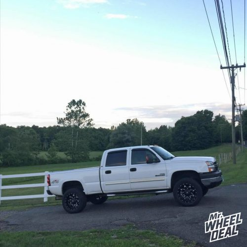 2006 Chevy Silverado 2500 with 20x10 Fuel Lethal Black Milled wheels with 305/55R20 Toyo ATII tires