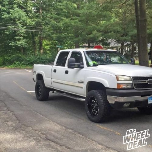 Black Milled 20x10 Fuel Lethal wheels with 305/55R20 Toyo ATII tires on a 2006 Chevy Silverado 2500