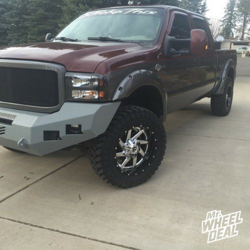 20x12 Black and PVD Chrome Fuel Renegade with 35x12.50x20 Atturo Trail Blade MT tires on a 2007 Ford F250