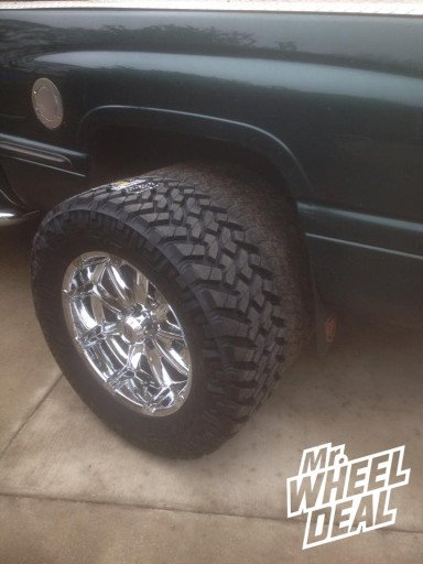 """20x9"""" XD Badlands Chrome Wheels with LT295/60/20 Nitto Trail Grappler Tires on a 1998 Dodge Ram 1500"""
