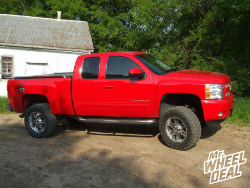 """Chevy Silverado with 20"""" Moto Metal 951 Chrome Wheels with 35x12.50x.20 Toyo Open Country MT Tires"""