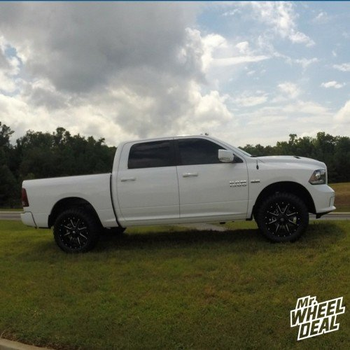 """20x9"""" Fuel Maverick Black Milled wheels with LT315/60/20 Toyo Open Country MT tires on a 2014 Ram 1500"""