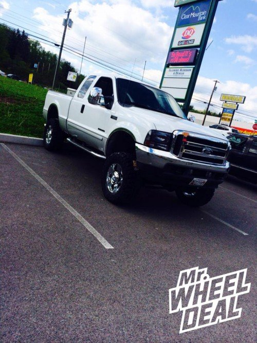 18x9 XD Rockstar Chrome wheels with 35x12.50x18 Federal Couragia MT tires on a 2001 Ford F250