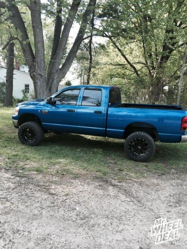 """20x12"""" Moto Metal 962 Gloss Black Milled wheels with 33X12.50R20 Federal Couragia MT tires on a 2008 RAM 2500"""