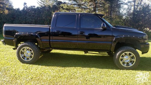 "20x10"" Fuel Off-Road Hostage Chrome wheels with 35x12.50R20 Atturo Trail Blade MT tires on a 2006 GMC Sierra 1500"